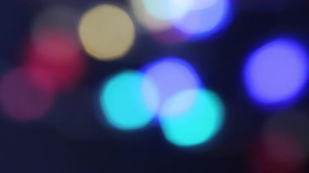 blurred lights : Out of focus colorful blurred festive lights moving on the black background Stock Footage