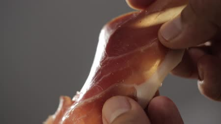 sponka : Chef holding thin slices of pork ham spanish jamon
