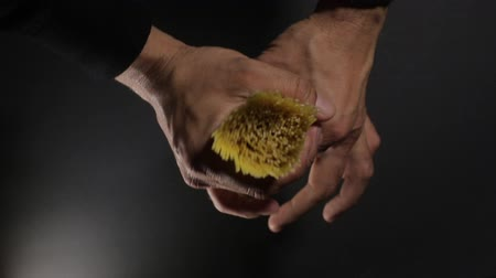 vermicelli : Man holds golden color raw spaghetti pasta on the dark black background Stock Footage