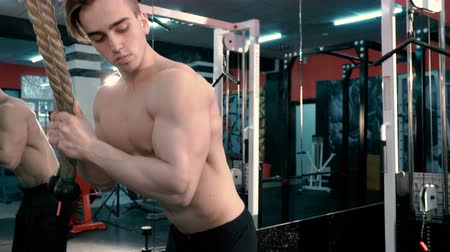 abs : Young Bodybuilder Doing Heavy Weight Exercise For Triceps