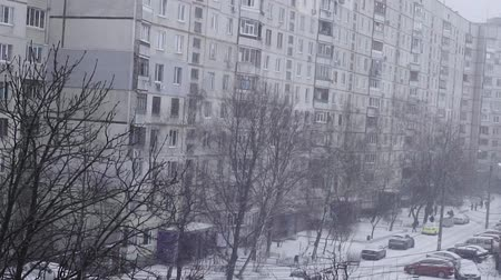 weather conditions : romantic snow fall scenery in urban cityscape environment. cold weather season