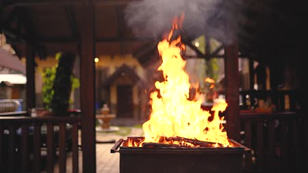 kebab : Fire in barbecue, kindling flame and conical fire burning apparatus. Slow motion.