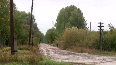 difficults : country road in Russia rain mud clay rubber boots Stock Footage