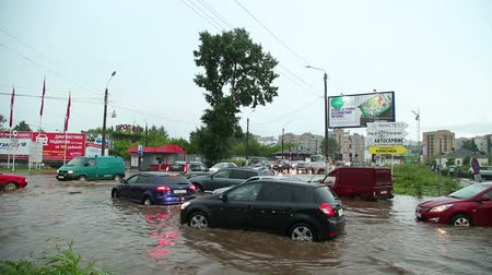 water taxi : people and cars on the flooded streets after a heavy rain Stock Footage