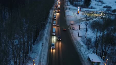 oświadczyny : aerial photography winter evening wedding convoy of limousines
