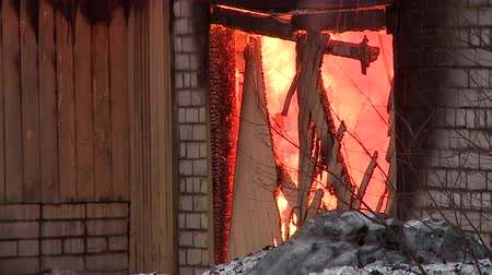 arson : rescuers extinguish a fire in the village Stock Footage