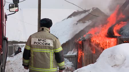 rescuer : rescuers extinguish a fire in the village Stock Footage