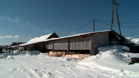 ekosistem : the mill in winter produces logs for the Russian hut