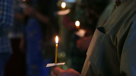 baptism : candles in the hands of believers in the Russian Orthodox Church Stock Footage