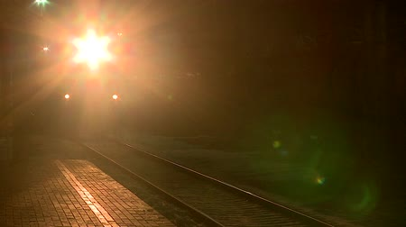 rapid transit : electric train at night in Russia Stock Footage