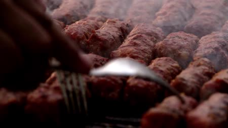 mici : Romanian traditional food Meat Balls mici on grill. Slow motion