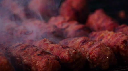 mici : traditional food Meat Balls mici on grill Stock Footage