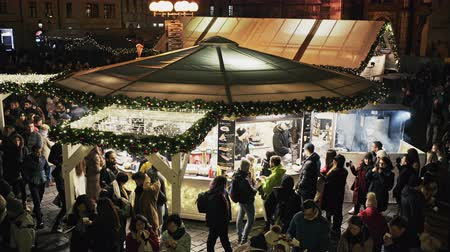 cseh : Prague, Czech Republic- December 25, 2017: Prague Christmas market on Old Town Square with gothic Tyne cathedral. Centre of Prague is UNESCO protected. Stock mozgókép