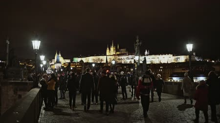 cseh : Prague, Czech Republic- December 25, 2017: Charles Bridge and Crusaders Square in Prague. Since 1992, historic center of Prague has been included in the UNESCO list of World Heritage Sites.