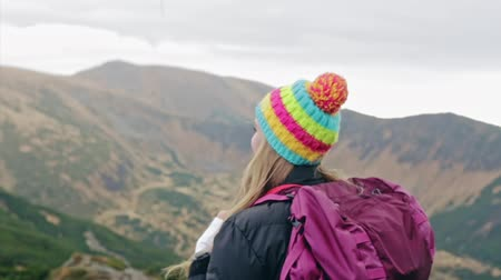Cheerful woman hiking with backpack