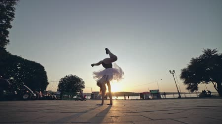 Young girl in pink ballet tutu is walking upside down. Stock Footage