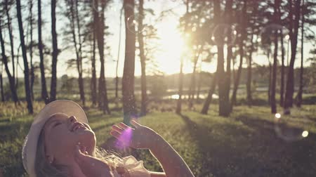 Young girl playing with soap-bubbles on sunny day Stock Footage