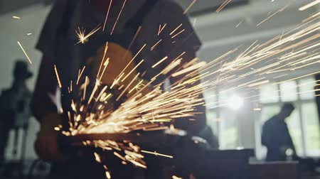 angle grinder : Closeup view of flying sparks from angle grinder in use by anonymous worker Stock Footage