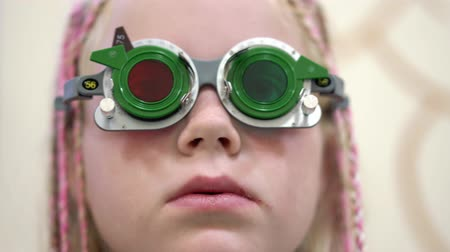 optometria : Eyesight check. Caucasian girl who have vision disabilities.Medical treatment and Rehabilitation Wideo