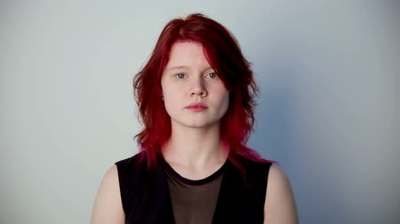 szörnyszülött : modern youth. calm portrait of a girl of unusual appearance with red hair.