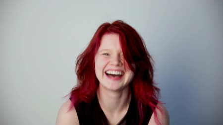 estandar : modern youth. Portrait of a cheerful girl unusual appearance with red hair.