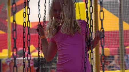 happy childhood of a modern child in the city - the girl having fun in an amusement park Dostupné videozáznamy