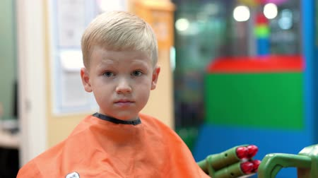 haircut of a little boy in a childrens hairdressing salon