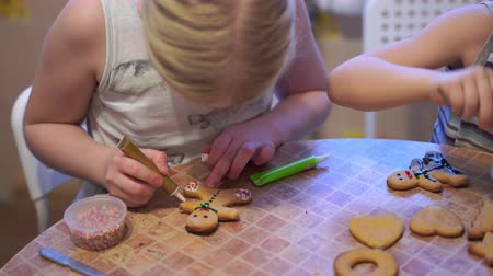 peperkoek : home video - happy kids making cookies at home in the kitchen