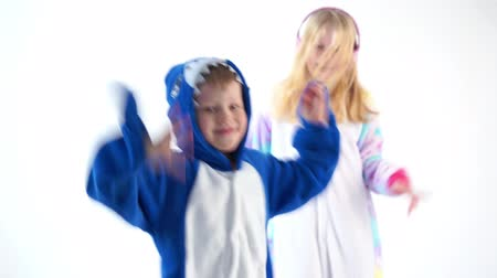 puericultura : children dancing fun on a white background in pajamas kigurumi