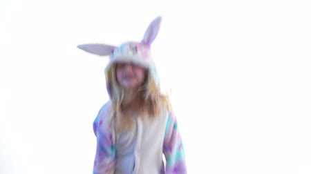 puericultura : modern fashion - beautiful blonde girl posing on a white background in kigurumi pajamas, bunny costume - isolated on white Stock Footage