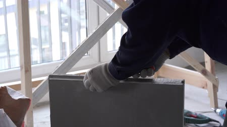 aerated : construction and repair - installation of an interroom partition from tongue-and-groove blocks