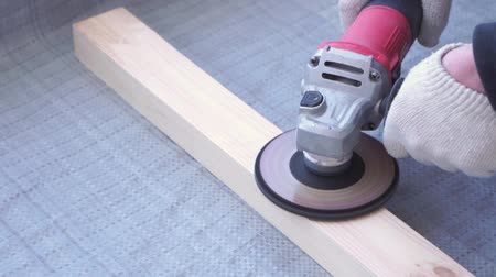 bricoleur : beauty of slow motion in construction and repair - master carpenter mounts pine wood floor - eco-friendly flooring. screwing lag to concrete.
