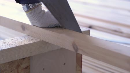 sawn : beauty of slow motion in construction and repair - construction work - a man sawing sawn wooden floor boards