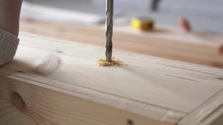 drilling wood : construction and repair. working with wood - drilling holes close up Stock Footage