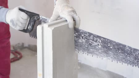 divisória : beauty slow motion in construction and repair - male builder sawing gypsum tongue-and-groove blocks