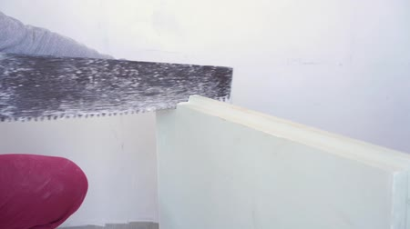 aerated : beauty slow motion in construction and repair - male builder sawing gypsum tongue-and-groove blocks