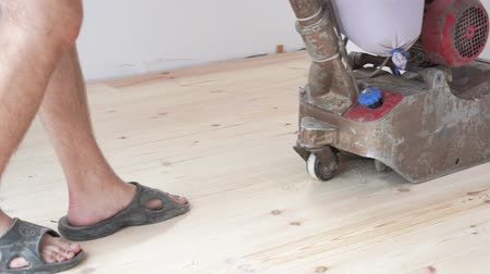 furnér : sanding a wooden floor with a grinder