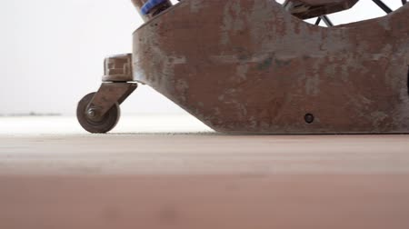 sander : sanding a wooden floor with a grinder