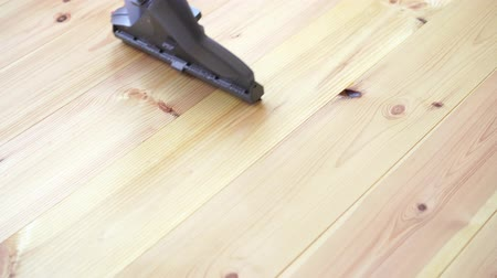 vácuo : cleaning a wooden floor with a washing vacuum cleaner