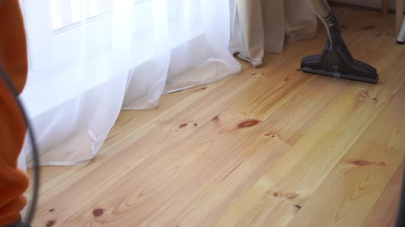 паркет : cleaning a wooden floor with a washing vacuum cleaner, slow motion