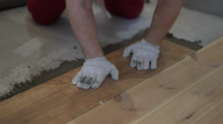 kielnia : repair and decoration. the tiler puts the porcelain tiles on the floor in the apartment