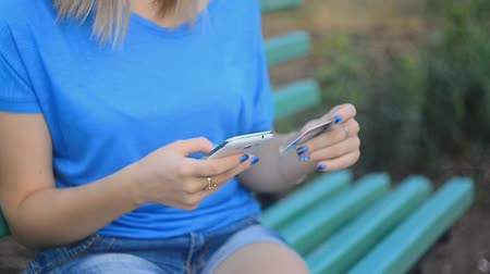 плата : Technology, shopping, banking, home and lifestyle concept - close up of woman with phone and credit card.