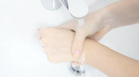 mosás : Close Up Of Woman Washing Hands.