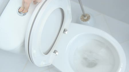 уборная : Water flushing in toilet bowl Стоковые видеозаписи