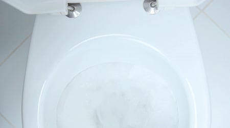 toilets : Water flushing in toilet bowl Stock Footage