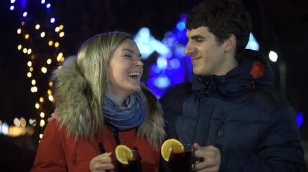 mulled wine : Romantic young couple drinking hot wine. Stock Footage