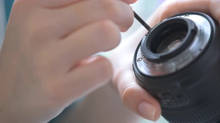 photography themes : Womans hands repair camera lens Stock Footage
