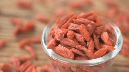 диета : Healthy eating and diet concept - dried goji berries Стоковые видеозаписи