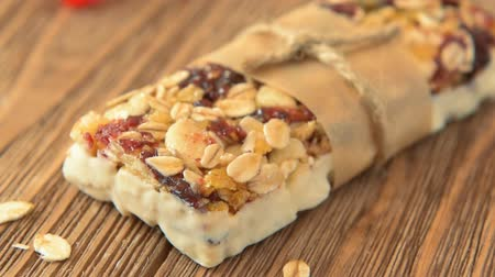 фрукты : Protein bars with peanut butter and dried fruit, healthy snack Стоковые видеозаписи