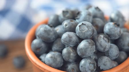 picked up : Fresh blueberry on a wooden background closeup. Stock Footage